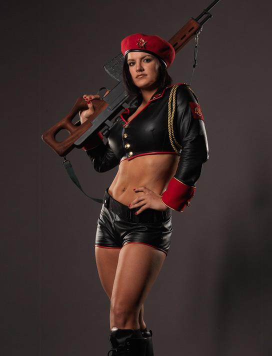 Babe as Natasha, packing some heavy tools...and the rifle too