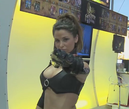 Hmmm...so she has a gun, but she's standing in front of an Everquest booth. That aint right.